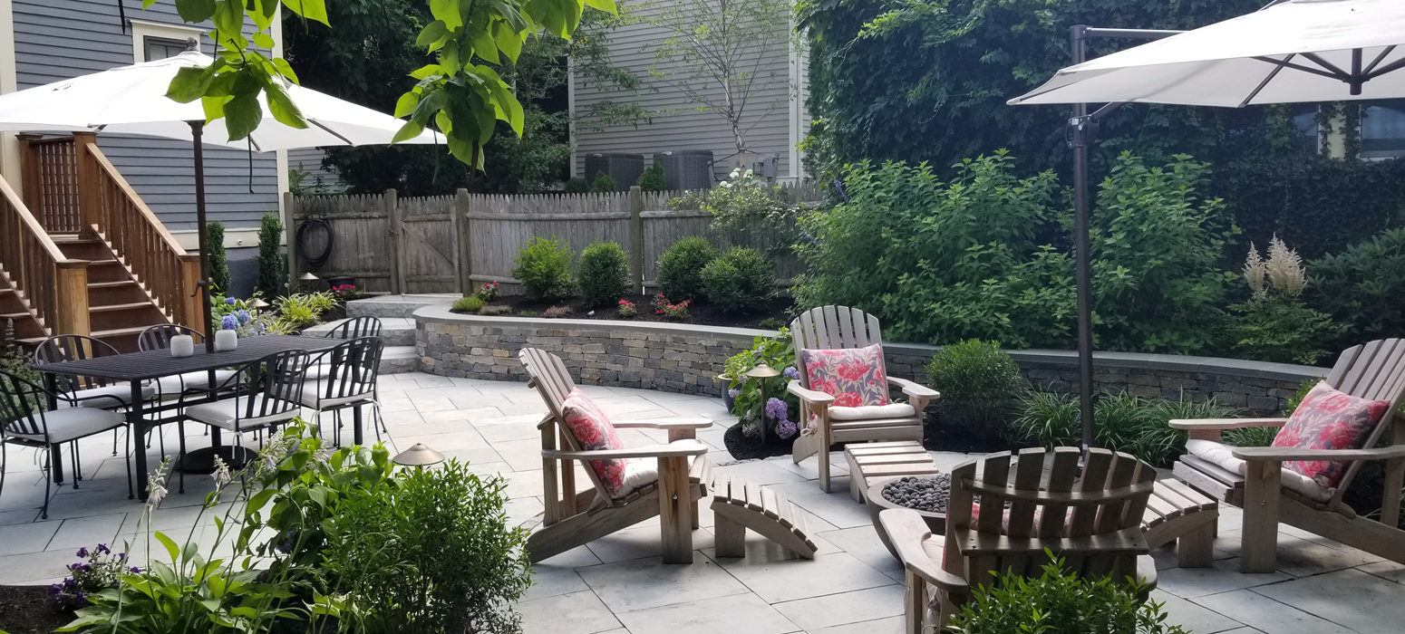Cozy lush backyard designed by Shalvey Bros Landscaping